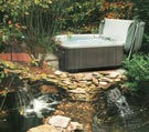 portable hot tub with rock garden picture
