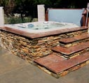 hot tubs for sale with stone surronding picture
